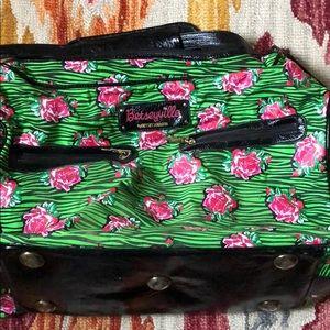 Betseyville green zebra & floral print weekend bag